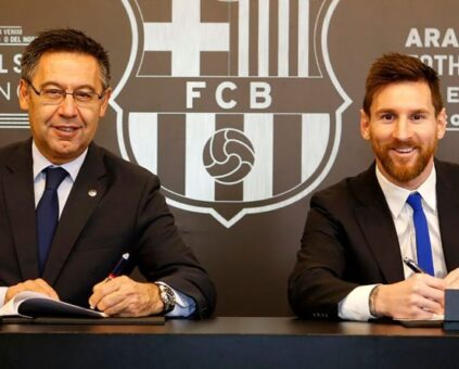 Lionel Messi and President of Barcelona